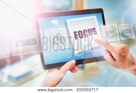 A Businesswoman Selecting A Focus Business Concept On A Futuristic Portable Computer Screen.
