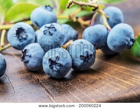 Blueberries on the wooden table. Macro shot.