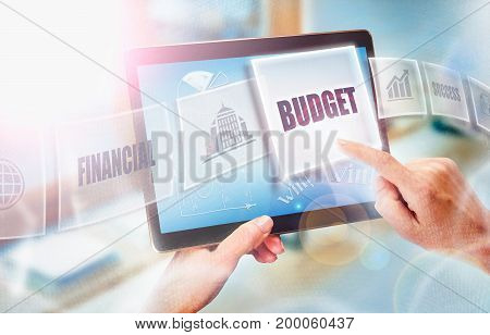 A Businesswoman Selecting A Budget Business Concept On A Futuristic Portable Computer Screen.