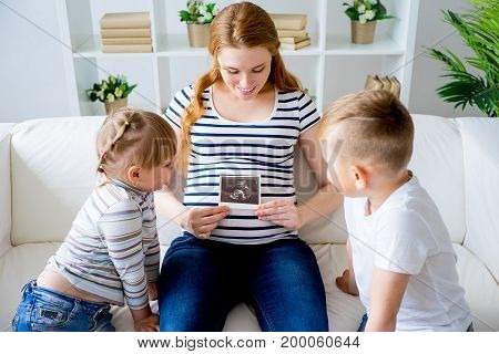 A portrait of a family with pregnant mother