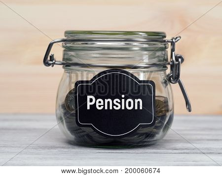 Glass jar with money. Money saving and pension concept