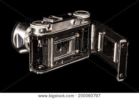 Very old photo camera isolated on black