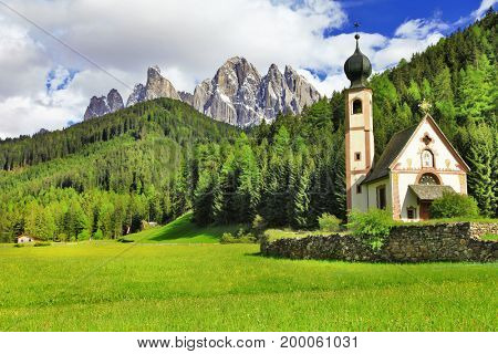 Alpine scenery - Dolomites mountains, Val di funes, view with church