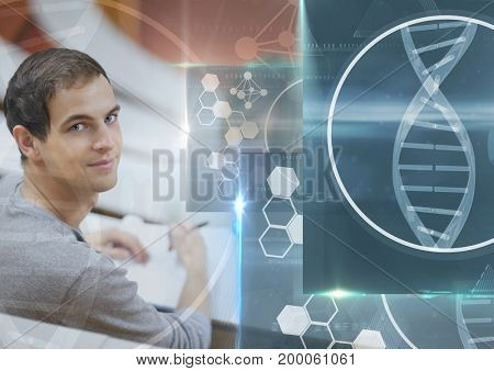Digital composite of Male Student studying with notes and science education interface graphics overlay