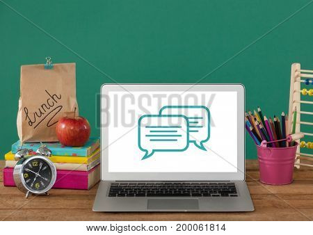 Digital composite of Chat icons on laptop with hands