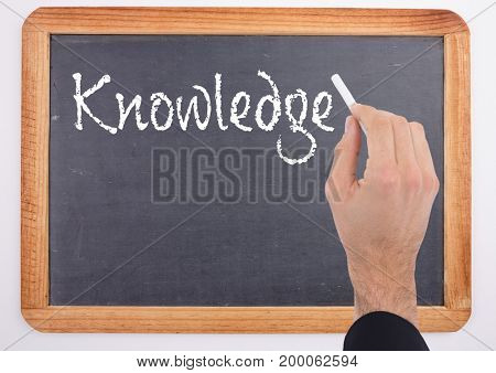 Digital composite of Hand writing Knowledge text on blackboard