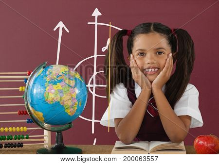 Digital composite of Student girl at table against red blackboard with school and education graphic