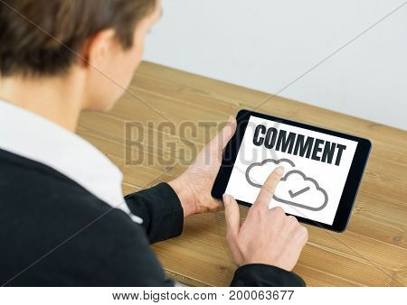 Digital composite of Comment text and cloud tick graphic on tablet screen with hands