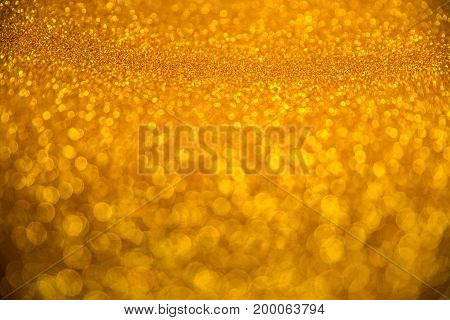 Yellow and gold blurred glitter christmas background