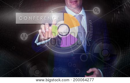 A Businessman Selecting A Conference Button On A Computerised Display Screen.