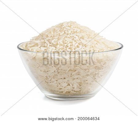 Heap of parboiled rice in glass bowl isolated on white background. Close up high resolution product. Healthy food.