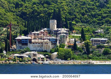 Athos peninsula, Greece. The Monastery of Dochiariou founded in the 10th century located in the Monks Republic on the peninsula of Athos. View from a cruise ship.
