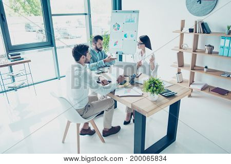 High Angle View Of Stylish Designed Office, Three Colleagues In Smart Outfits Are Focused On Data, F