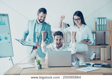 Yes! We Did It! Success And Team Work Concept. Team Of Three Business Partners With Raised Up Hands