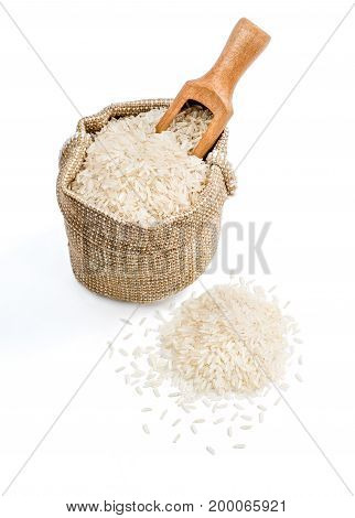 Burlap sack with parboiled rice and scoop isolated on white background. Healthy food. High resolution product