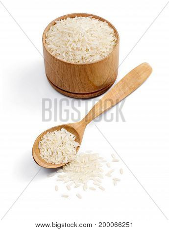 Healthy food. Wooden bowl and spoon with parboiled rice isolated on white background. Healthy food. Copy space. High resolution product