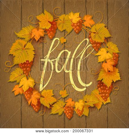 Vector wreath of autumn grape leaves and berries on a dark wood background. Hand lettering Fall. Grapes branch frame.