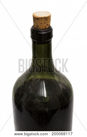 Glass clean single shiny beautiful classic closed old dirty aged green bottle of an alcohol wine drink or liquid with a plug on isolated white background.
