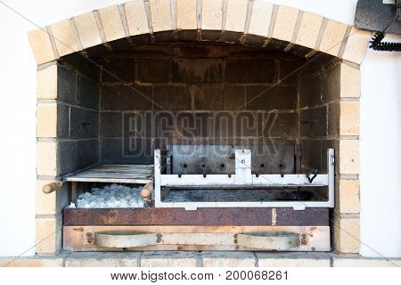 Brazier with skewers. Barbeque and grill outdoor