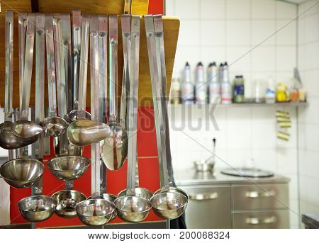 Kitchen utensils. Metal Scoops in kitchen .