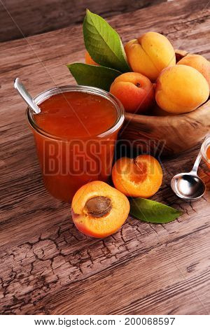 Apricot Jam In Glass Bowl With Fruit Around