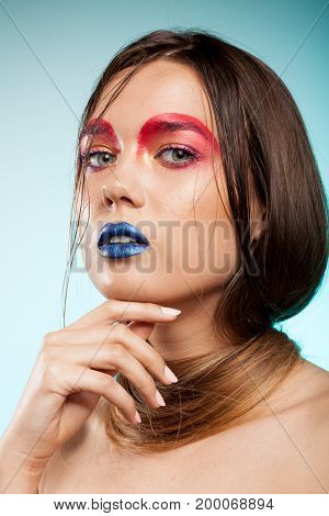 Gorgeous beautiful young model with creative hairstyle. Beauty and fashion. Artistic on stage make up