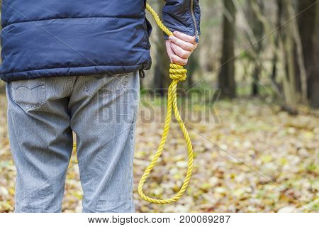 Man with gallows noose at outdoor .