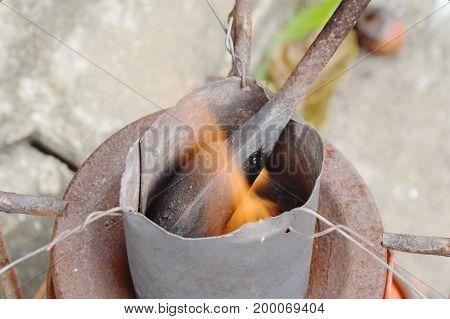 soldering iron burn in tin bucket for steel welding work