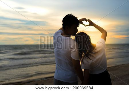 Young man and girl couple romantic dancing love leisure in celebration before married happy and fun at beach sunset vacation holidays valentine day concept.