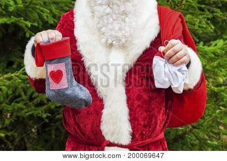Santa Claus with christmas sock and gift bag
