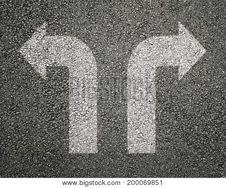 Two white arrows on asphalt in backgrounds