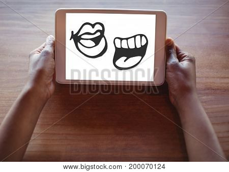 Digital composite of Mouth cartoons on tablet in hands