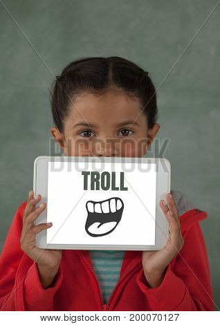 Digital composite of Troll text with cartoon mouth on tablet over girls face