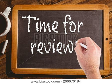 Digital composite of Hand writing time for review on blackboard