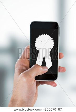 Digital composite of Person holding a phone with a trophy icon