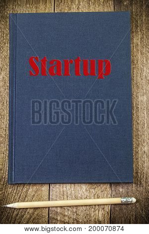 Start-up inscription concept on notebook in backgrounds