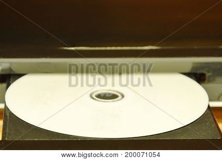 DVD put on insert disc player in wooden cupboard
