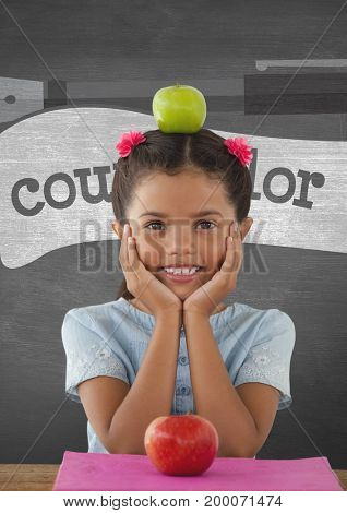 Digital composite of Happy student girl at table against grey blackboard with education and school graphics