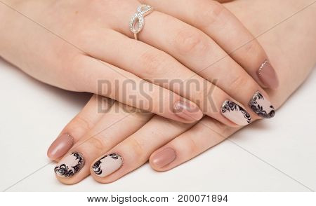Nail Care And Manicure. Closeup Of Beautiful Female Hands Applying Transparent