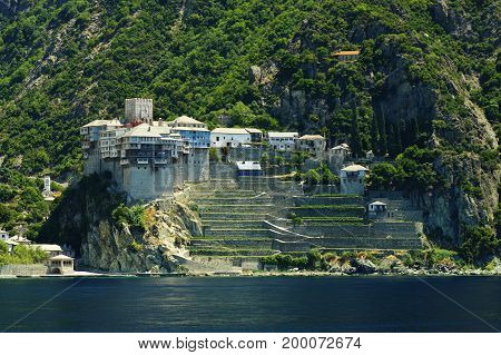 Athos peninsula, Greece. The Monastery of Dionysiou located in the Republic of Monks on the peninsula of Athos.located in the Republic of Monks on the peninsula of Athos. View from a cruise ship.