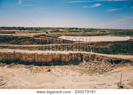 Open cast limestone yellow mining quarry landscape, toned