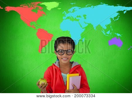 Digital composite of Schoolgirl holding books in front of colorful world map
