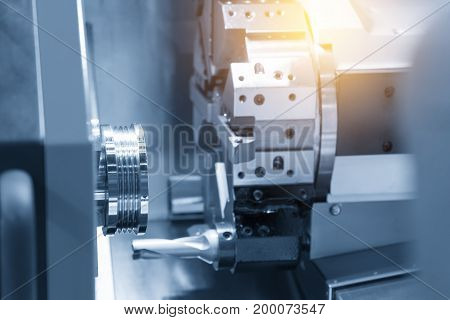 Abstract scene of CNC lathe machine (Turning machine) while cutting the screw thread on the tube.The hi-technology machining concept.