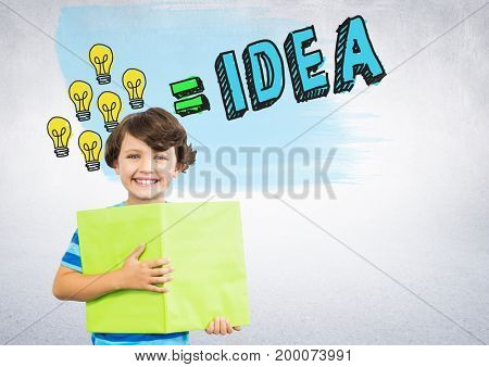 Digital composite of Boy holding book in front of colorful light bulbs idea graphics