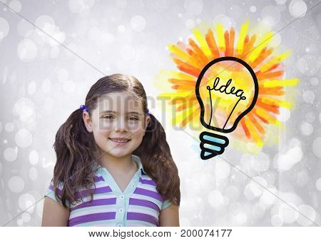 Digital composite of Girl with colorful idea light bulb and sparkling lights bokeh background