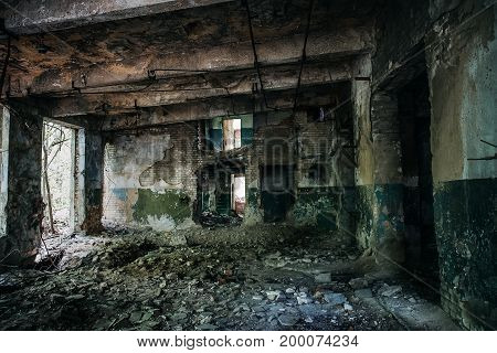 Corridor in abandoned factory building, empty room