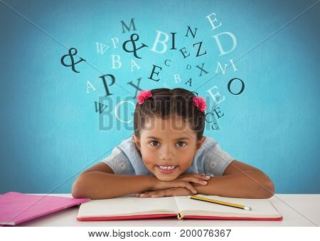 Digital composite of Many letters around Schoolgirl at desk with blue background