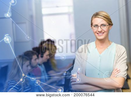 Digital composite of Teacher with students on computers