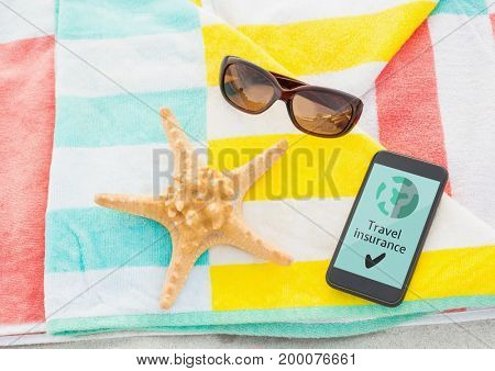 Digital composite of Phone with travel insurance concept on screen