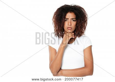 Image of sad young african lady standing isolated over white background. Looking camera.